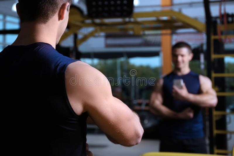 Young handsome man taking selfie in gym stock images