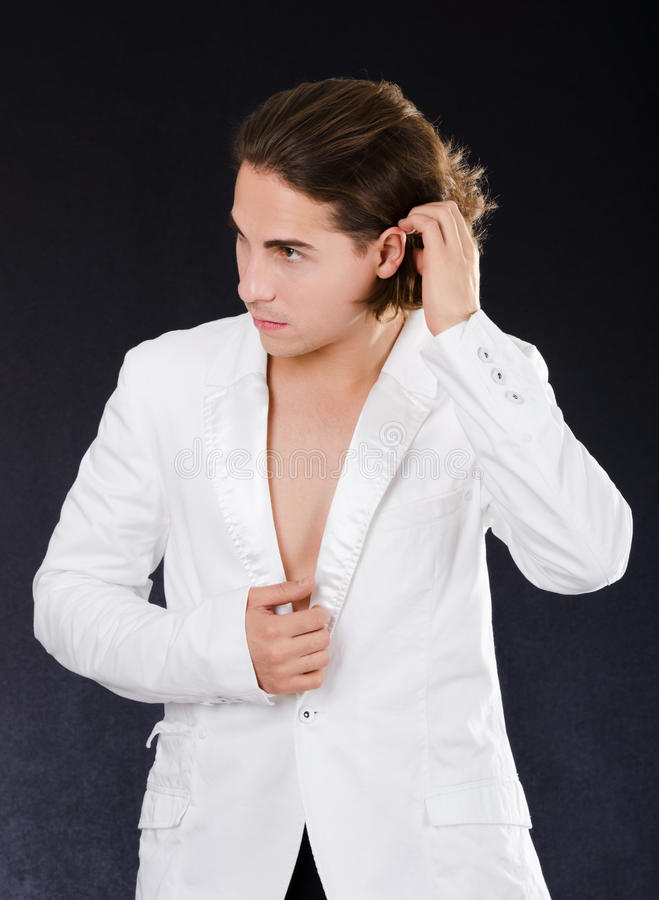 Handsome man in white jacket royalty free stock photo