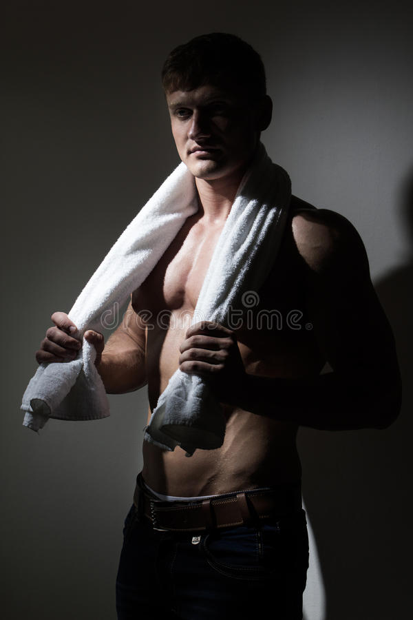 Young handsome man with white towel royalty free stock photos