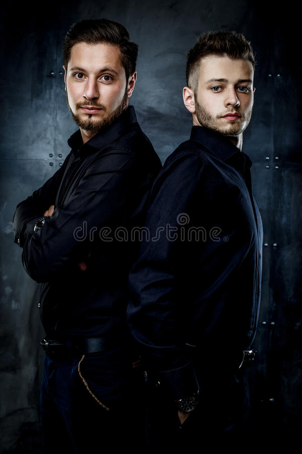 Young handsome men. Elegant young handsome men. Studio fashion photo stock photography