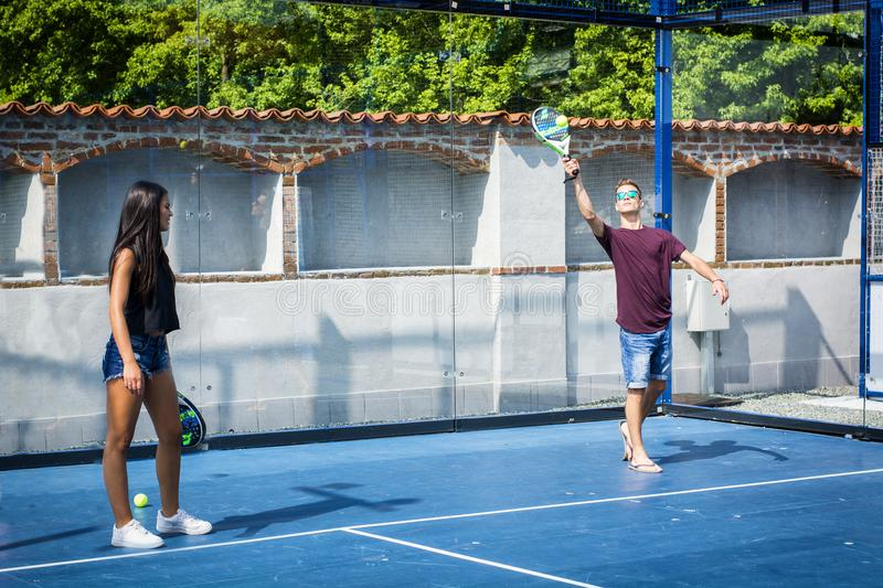Young people playing tennis on playground royalty free stock photography
