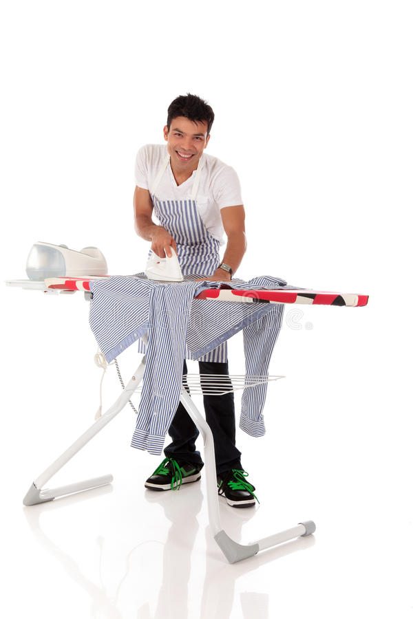 Young handsome Nepalese man, ironing royalty free stock image