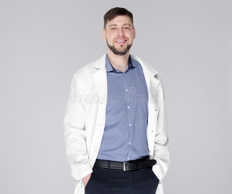 Young handsome pharmacist standing on background royalty free stock photography