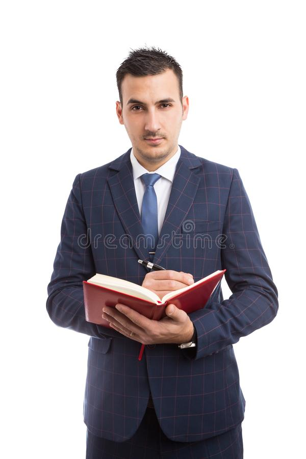 Free Young Handsome Salesman Writing In Agenda Royalty Free Stock Images - 114224379