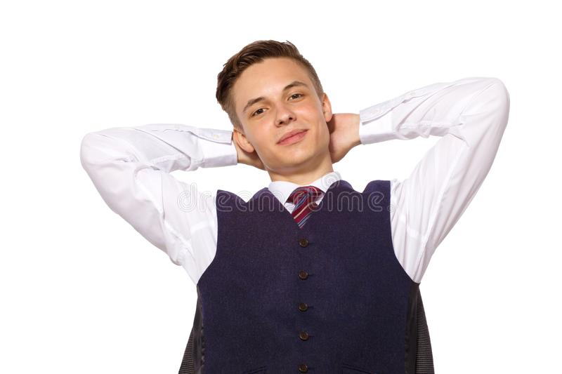 Young handsome smiling businessman relaxing after good deal isolated on white.  royalty free stock photo