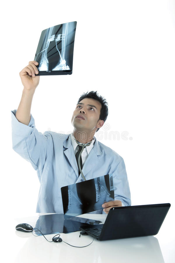 Young handsome successful Nepalese male doctor royalty free stock images