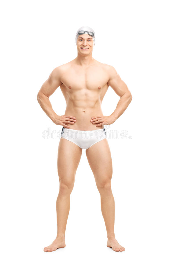 Young handsome swimmer posing in white swim trunks. Full length portrait of a young handsome swimmer posing in white swim trunks isolated on white background stock photography