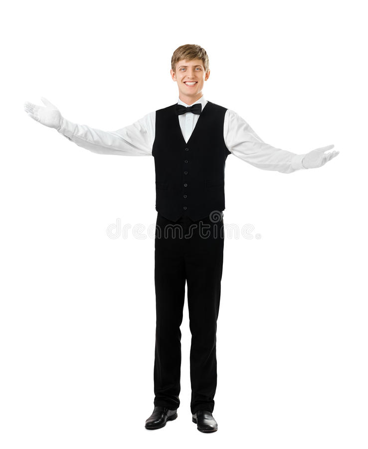 Young handsome waiter gesturing welcome royalty free stock photography