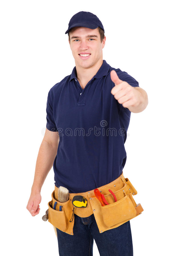 Young handyman thumb up. Portrait of handsome young handyman giving thumb up royalty free stock image