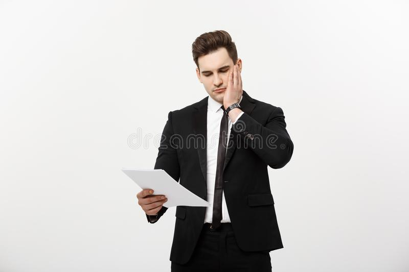Young hansome businessman with a document in his hands isolated over white background. royalty free stock image