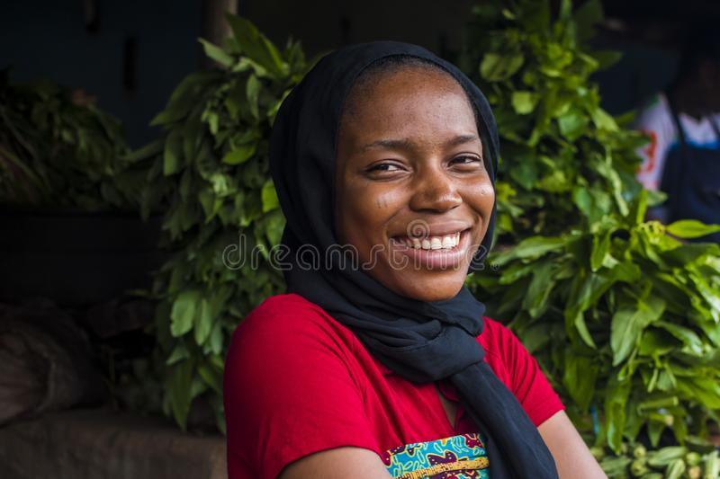 young happy african woman selling in a local market laughing stock images