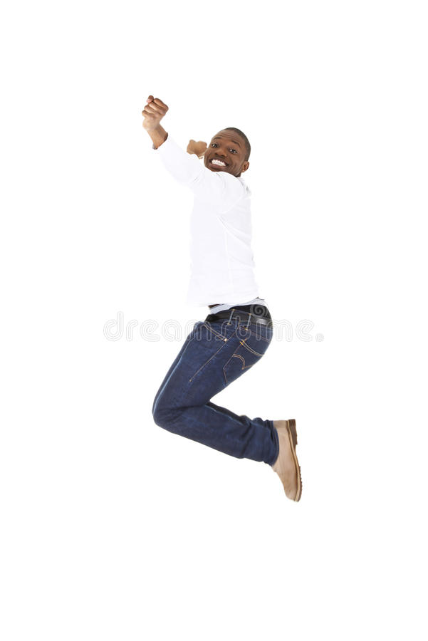 Young happy afro american man jumps in joy. Over white background stock photo