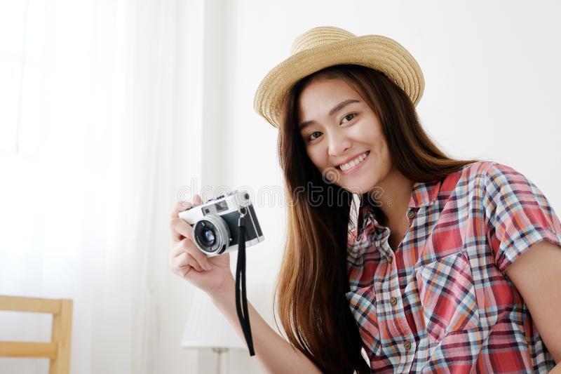 Young happy asian woman tourist holding camera, Asian traveler girl smiling while holding vintage camera on vacation royalty free stock photo