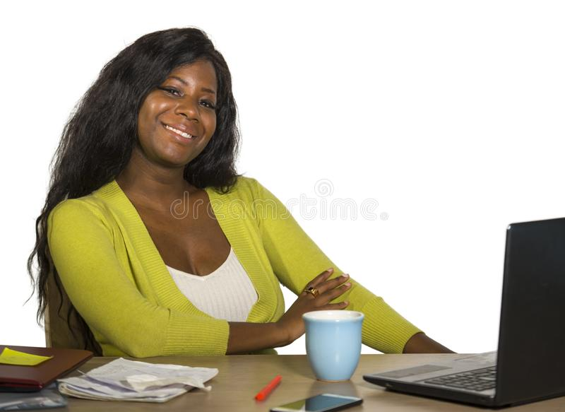 Young happy and attractive black African American business woman smiling cheerful and confident working at office computer desk re. Laxed in successful stock photos