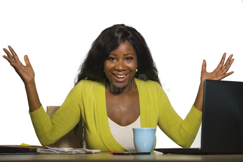 Young happy and attractive black African American business woman smiling cheerful and confident working at office computer desk ce. Lebrating success and job royalty free stock photography