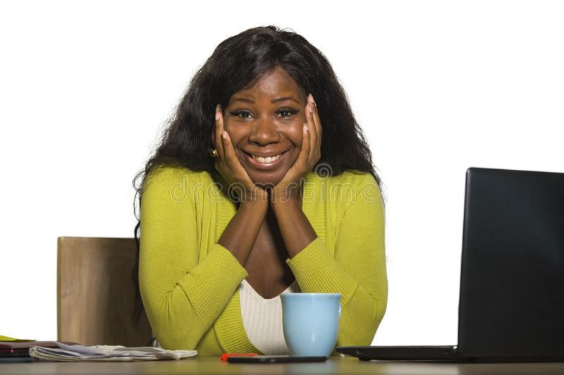 Young happy and attractive black African American business woman smiling cheerful and confident working at office computer desk re. Laxed in successful royalty free stock images