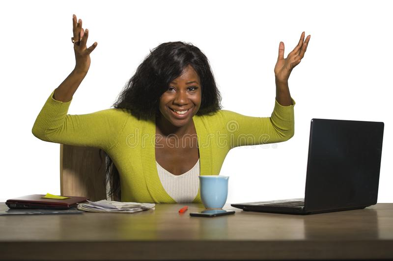 Young happy and attractive black afro American business woman smiling cheerful and confident working at office computer desk celeb. Rating success and job stock photo