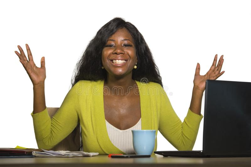 Young happy and attractive black afro American business woman smiling cheerful and confident working at office computer desk celeb. Rating success and job stock image