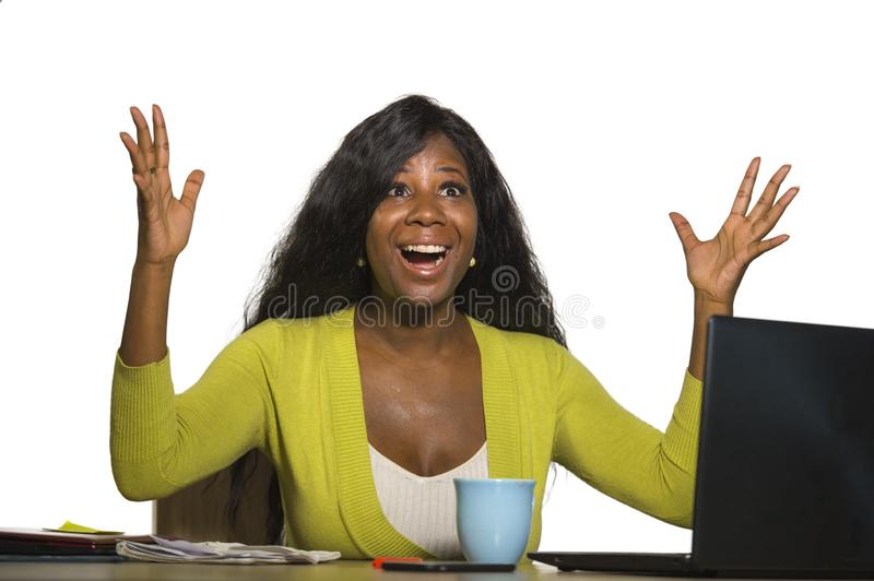 Young happy and attractive black afro American business woman smiling cheerful and confident working at office computer desk celeb. Rating success and job royalty free stock images