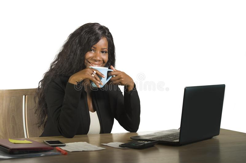 Young happy attractive black afro American business woman working at office computer desk smiling successful posing corporate drin. Young happy and attractive royalty free stock photography