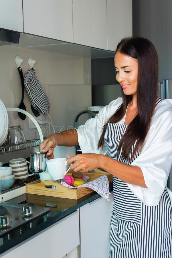 Young happy beautiful brunette woman apron white royalty free stock photography