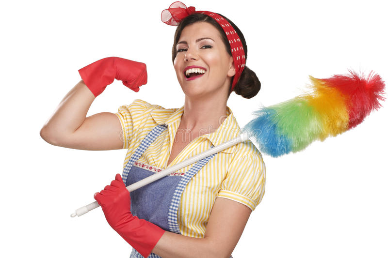 Young happy beautiful woman maid dusting on white. Background stock photo