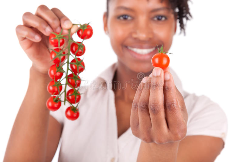 Download Young Happy Black / African American Woman Holding Tomatoes Stock Photo - Image: 30155902