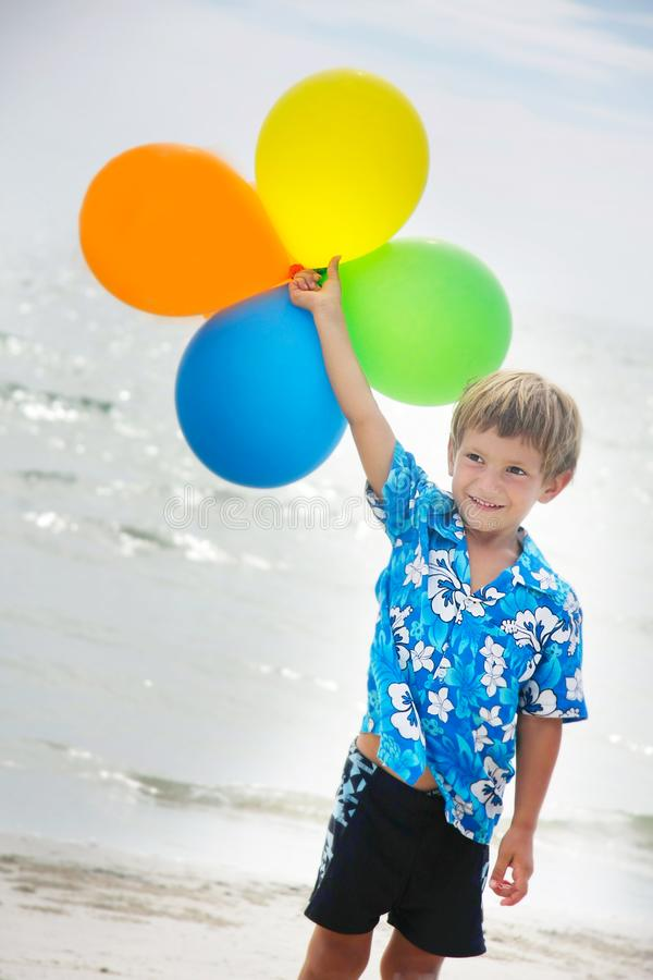 Download Young Happy Boy Running With Balloons Stock Photo - Image of little, sand: 18784186