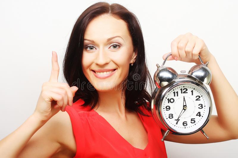 Young happy woman with alarmclock stock photos