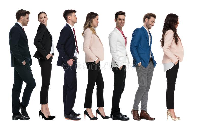 Young happy business people standing and waiting in line royalty free stock photography