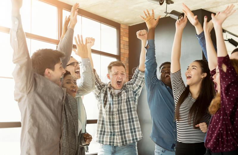Young business team enjoying success at office stock photos