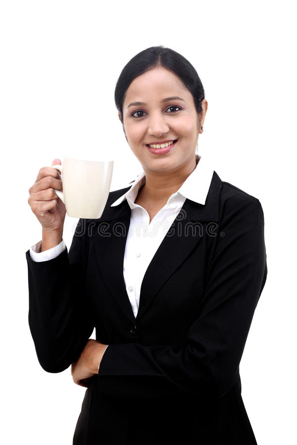 Young happy business woman with a cup of coffee royalty free stock image