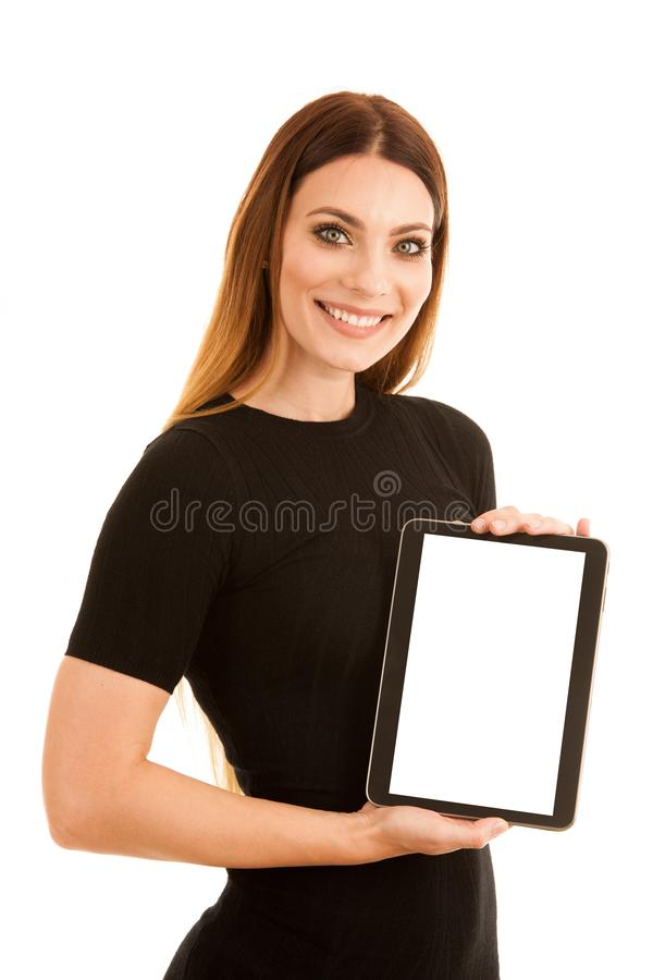 Young happy business woman shows a tablet wth blank display isolated over white background royalty free stock photo