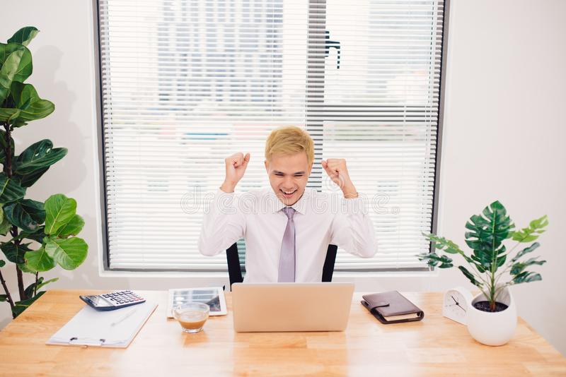 Young happy businessman with really impressive achievements, vic royalty free stock photo
