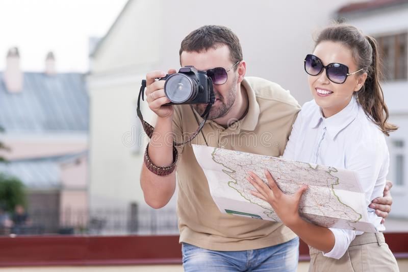 Young Happy Caucasian Couple Taking Pictures During Their Trip in City royalty free stock photos
