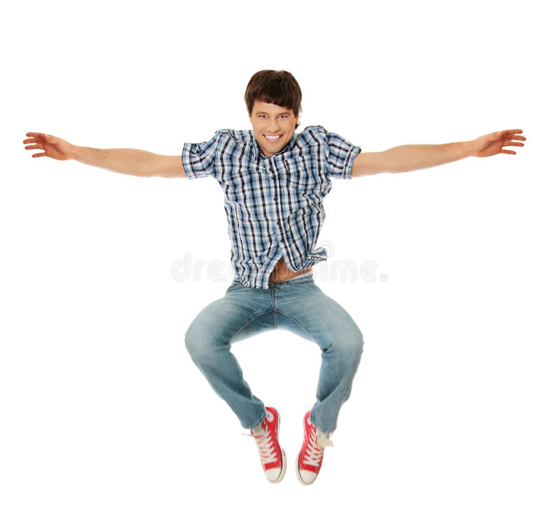 Young happy caucasian man jumping stock photography