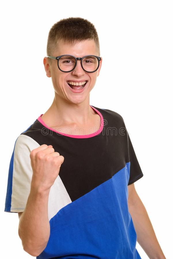 Young happy Caucasian nerd man smiling and looking motivated. Isolated against white background stock photo