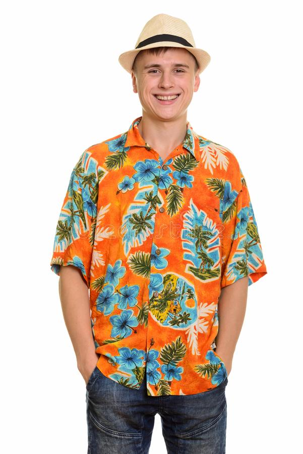 Young happy Caucasian tourist man smiling and wearing hawaiian shirt stock photo