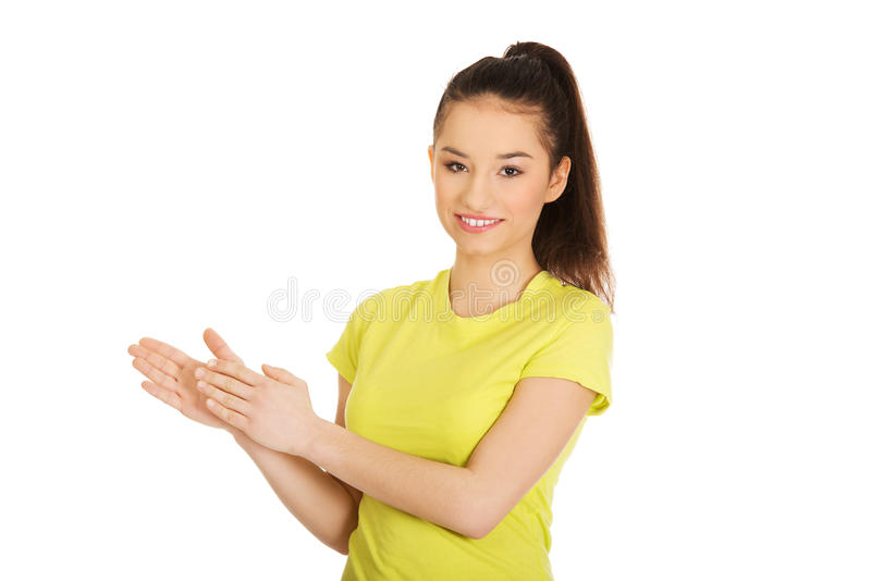 Young happy clapping woman. Happy teenager clapping her hands royalty free stock photo
