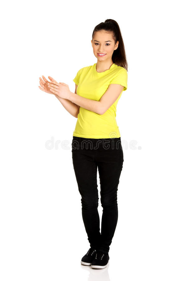 Young happy clapping woman. Happy teenager clapping her hands stock photography