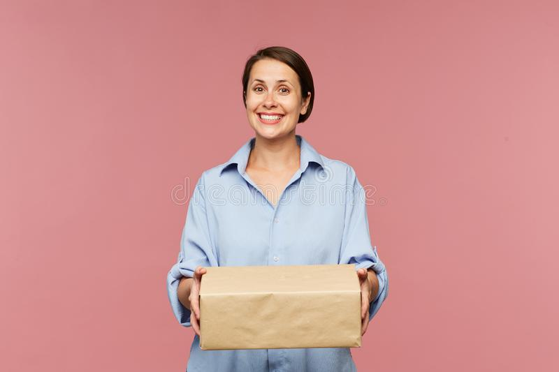 Young happy client of online shop with big packed box royalty free stock images