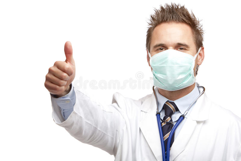 Young happy confident male doctor show thumb stock photo