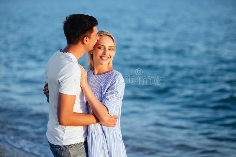 Young happy couple on beach at summer vacation royalty free stock images