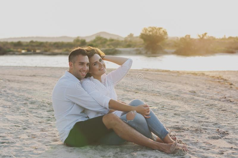 Young happy couple on the beach royalty free stock photos
