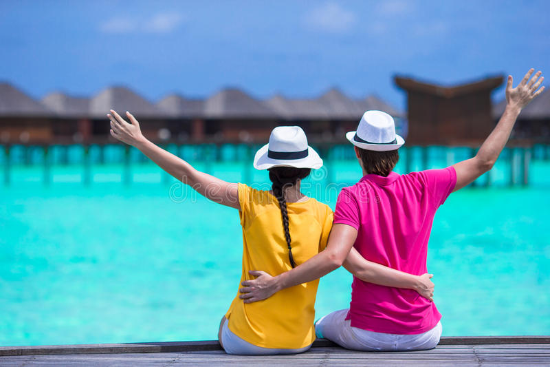Young happy couple during beach tropical vacation. Young happy couple have fun on summer tropical vacation stock image