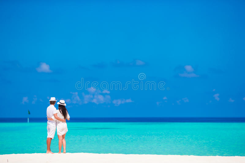 Young happy couple during beach tropical vacation. Young happy couple have fun on summer tropical vacation stock photography