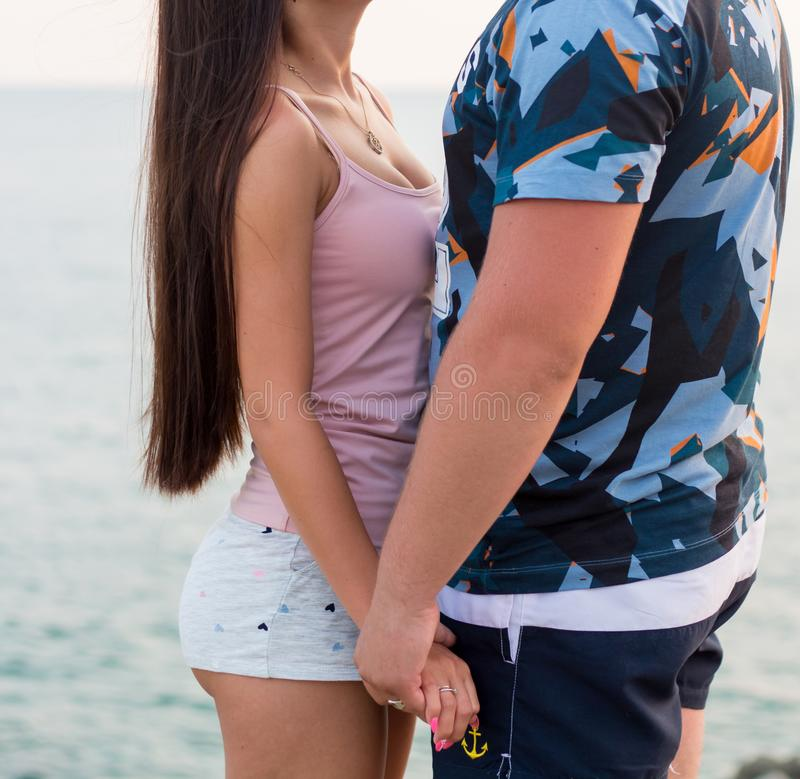 Young happy couple on the beach stock photography