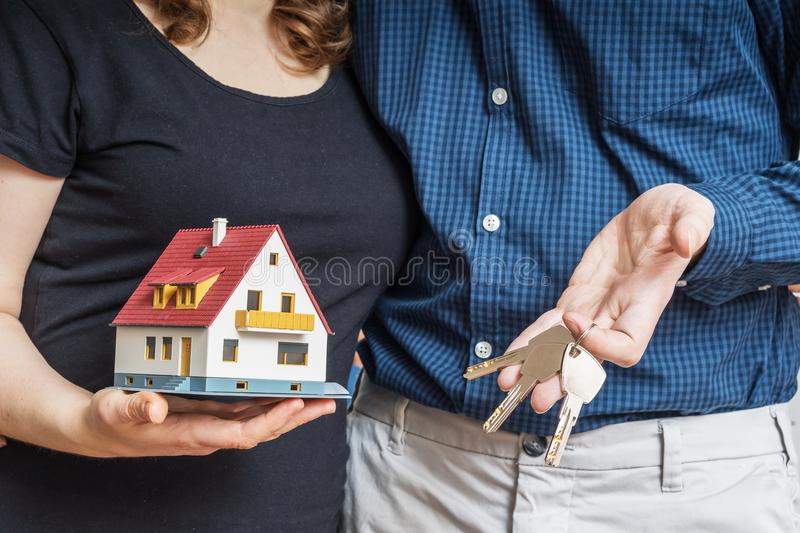 Young happy couple is buying new house stock images