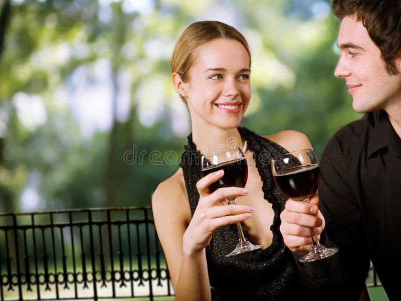 Young happy couple drinking