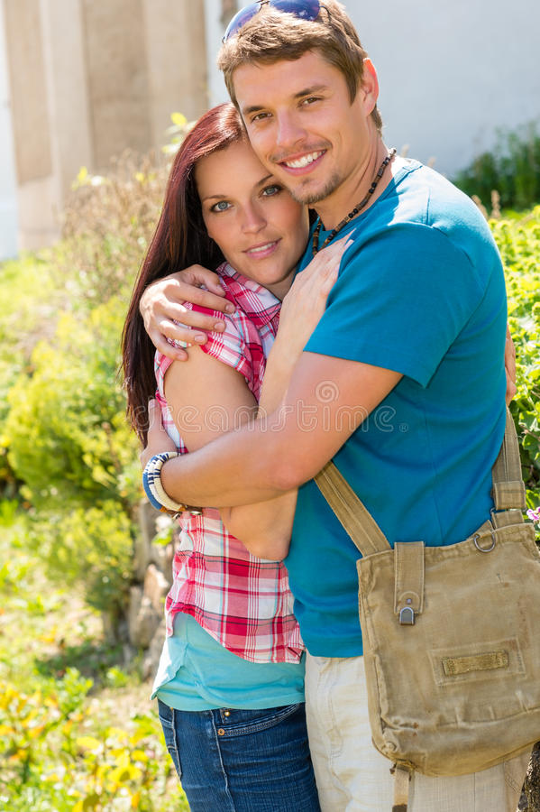 Young happy couple embracing in sunny park royalty free stock photo